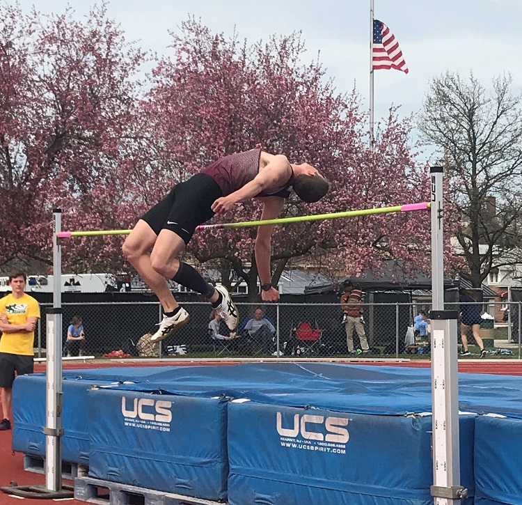 Kyle Kapella jumping over the bar in the high jump