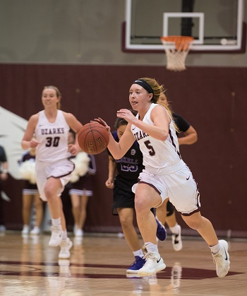 CofO''s #5 Kelsie Cleeton dribbling down the court with #30 Lakin Simmerman in the background