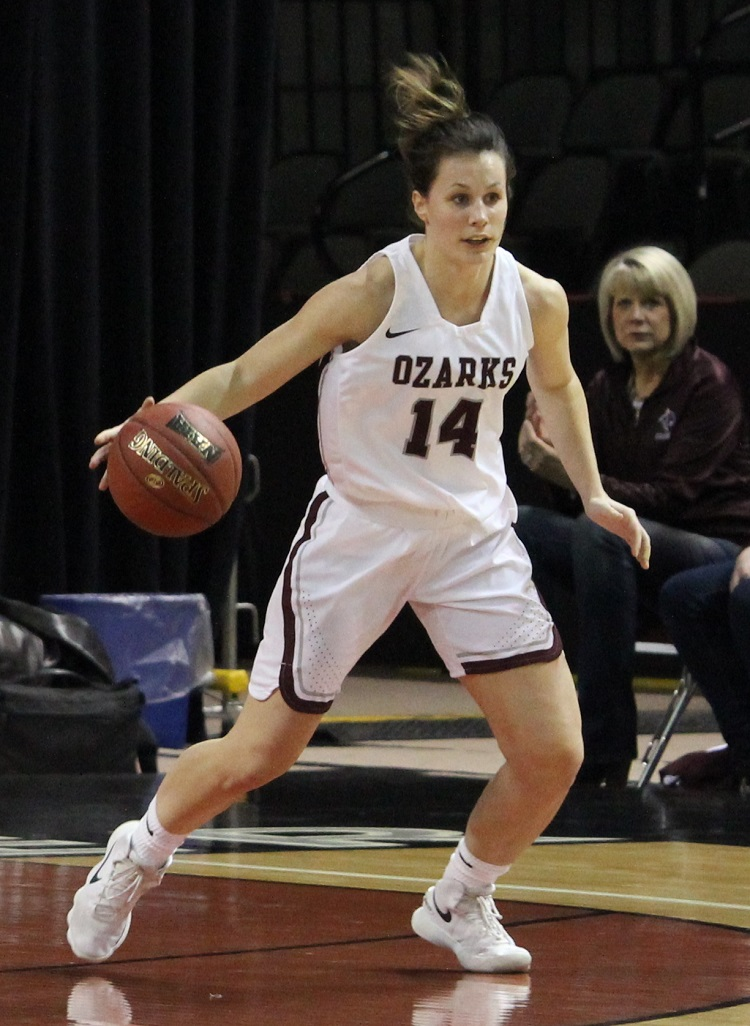 CofO #14 Cass Johnson dribbling down the court at NAIA tourney
