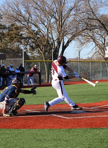 Chad Resuch at the plate hitting a ball with catcher in the background