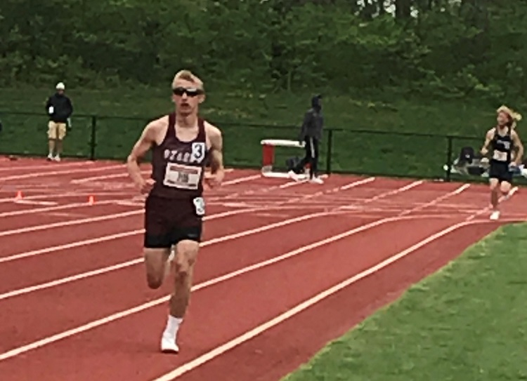 Ty Durnell in the foreground running 800m race with another runner behind in background