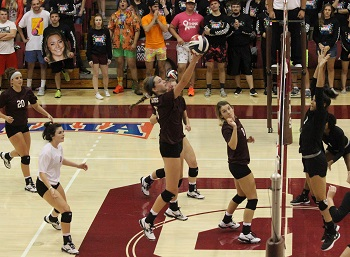 Acton shot from season with Kayli Grant hitting the ball over the net