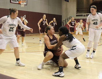 A scramble for possession of the ball between College of the Ozarks and Crowley''s Ridge