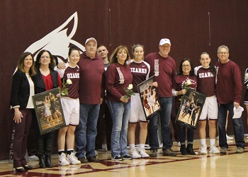 Lady Bobcat Seniors with their parents and Coach Vest