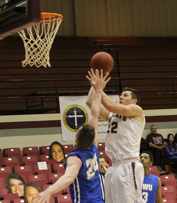 #22 Ethan Davidson taking a two point jump shot against Johnson & Wales Univ.