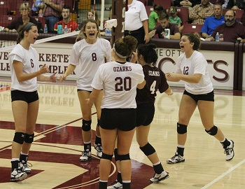 several team members meeting together on the court to celebrate a point