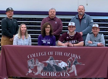 Signing day pic - Seated at table:  Tara Whetzell (sister), Cindy Hill (mom), Rhett Hill, Brandon Hill (dad) ; back row, Nick Whetzell (brother-in-law), Bobcat Head Coach Neale Richardson, and Assistant Coach Justin McMillin