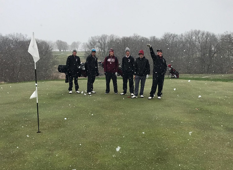 members of the golf team at the course with snow falling