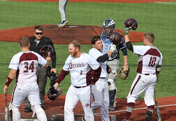 Celebration at home plate following Daggs homerun