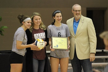 Senior Lady Bobcats accepting Runner Up Plaque from Hank Moore-NCCAA VB Chair