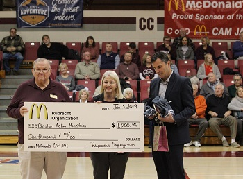 Larry Johnson of CAM receiving check from Rhonda Hall of McDonald''s Accompanied by College''s Athletic Director Steve Shepherd