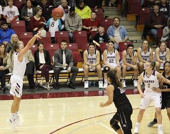 Madi Brethower taking a three point shot
