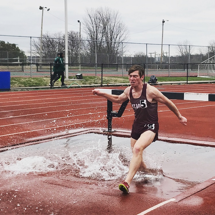 Preston Burgess running in the steeplechase
