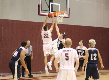 Ethan Davidson scoring at the basket with defender in front of him