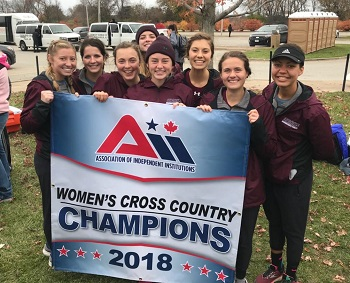 Women''s Cross Country team pictured with the championship banner