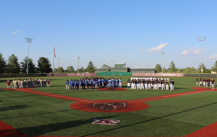 All teams competing in the NCCAA Central Regional Tournament on the field facing the flag for the National Anthem