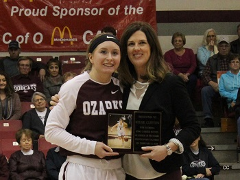 Kelsie Cleeton receiving her 1000 career point plaque from Coach Vest