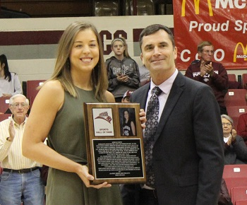 Athletic Director Steve Shepherd presenting Morgan Smith with her Hall of Fame plaque at half-time of the women''s basketball game
