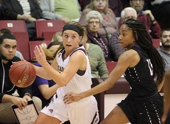 Kelsie Cleeton driving to the basket with opponent attempting to block
