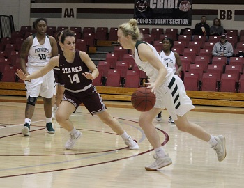 Cass Johnson #14 playing defense against Crowley''s Ridge College