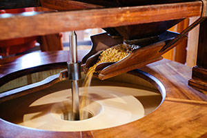 Close up of Edwards Mill at College of the Ozarks grinding up grains
