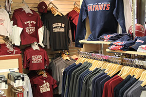 Wall and rack of The College of the Ozarks clothing merchandise at the C of O Bookstore