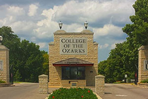 Main stone gateway and road with College of the Ozarks sign displayed