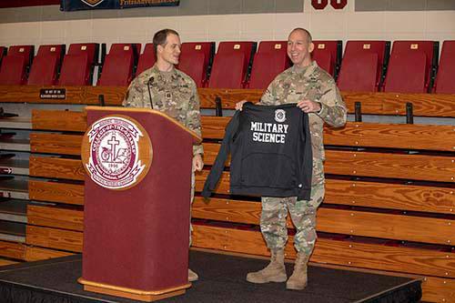 C of O presents military science sweatshirt to Brigadier General David Boyle.