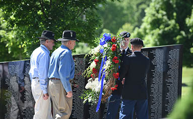 Veterans during wreath-laying ceremony at Patriots Park