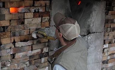 Man closing kiln