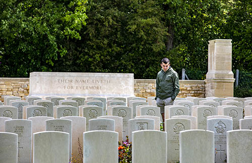 Student experiences somber moment in Dieppe Canadian War Cemetery in France.