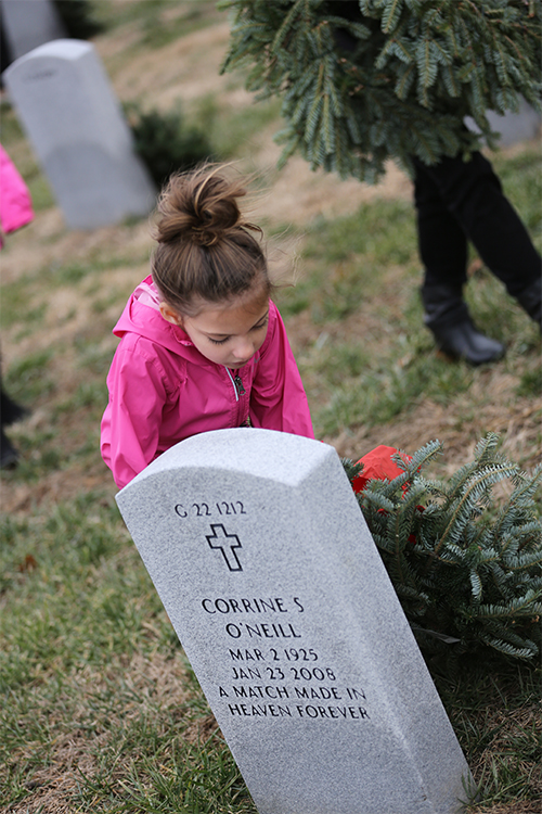 S of O first grader, Paisley Cizek participates in ceremony to lay wreaths.