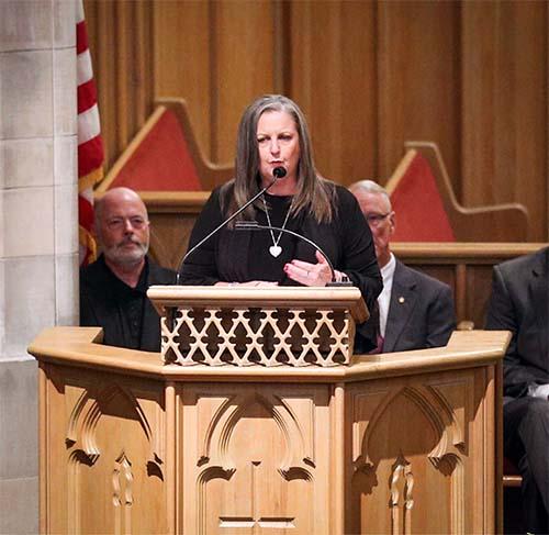 Karen Best, Branson Mayor, speaks at the Ozark Mountain Community Memorial Service.