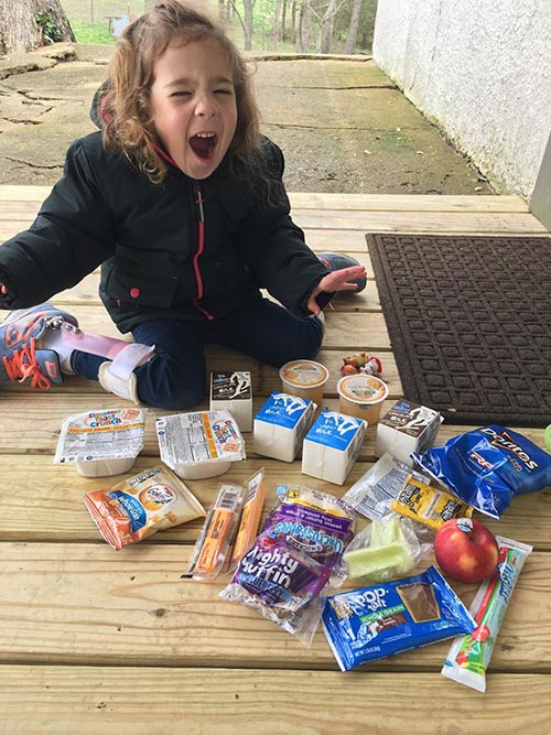 Pre-school student receives meal items