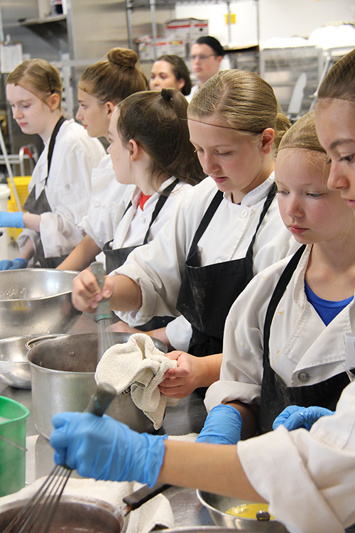 Children ranged in ages from 12 to 18 enjoy cooking and learning about the culinary arts.
