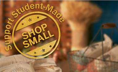 Small Business Logo with student-made product in the background