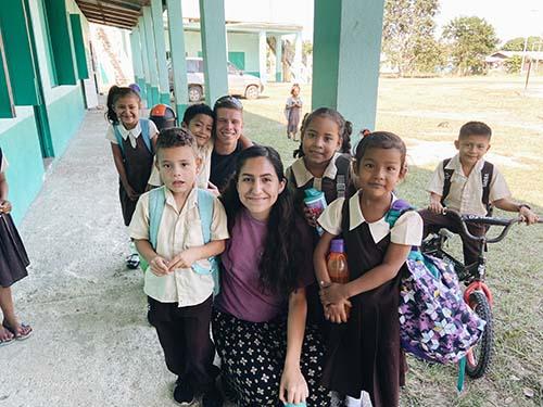 Students with Belizean Children