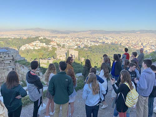 Amy Martin, assistant professor of humanities, speaks to students about the significance of the Acropolis of Athens.