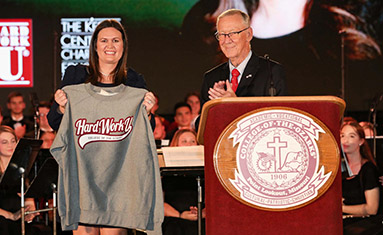 President Jerry C. Davis presents College of the Ozarks sweatshirt to