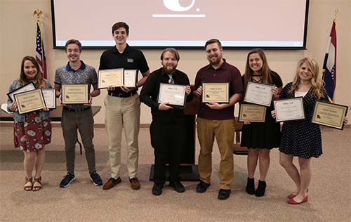 Students receive awards for journalistic efforts.