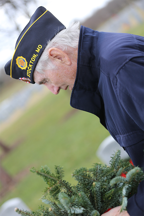 Vet lays wreath at Missouri State Veterans Cemetery.