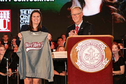 College President, Jerry C. Davis continues the tradition of presenting honored guests with a Hard Work U. sweatshirt. (Photo by Kevin White)