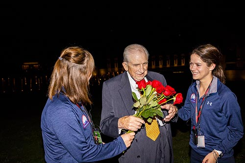 Students present roses to Veteran.