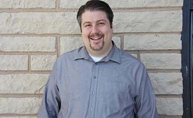 Dr. John Cornish, assistant professor of music and director of choral activities at C of O