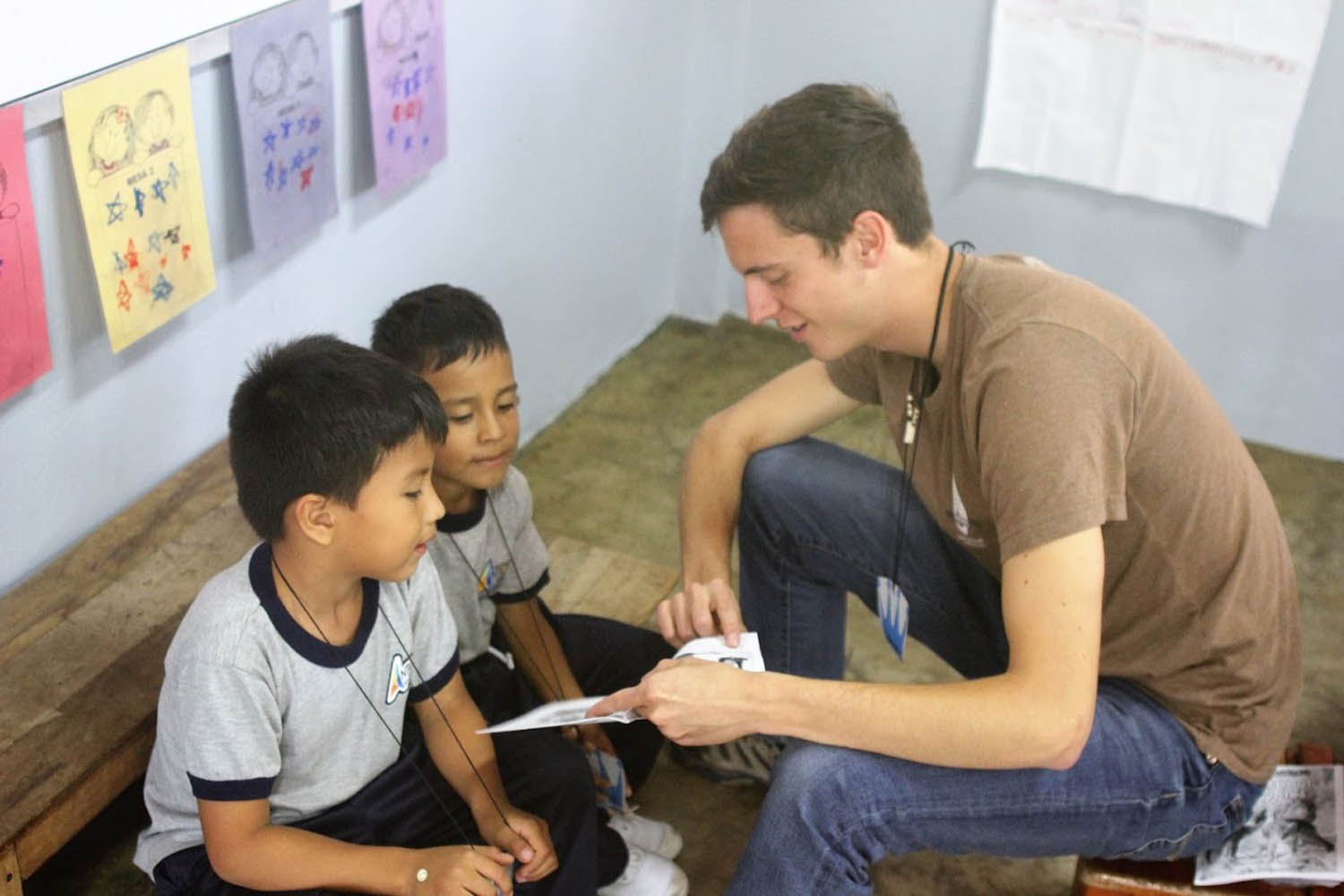 Students in the Amazon Jungle are read to by Johnny Cummings during study abroad trip.