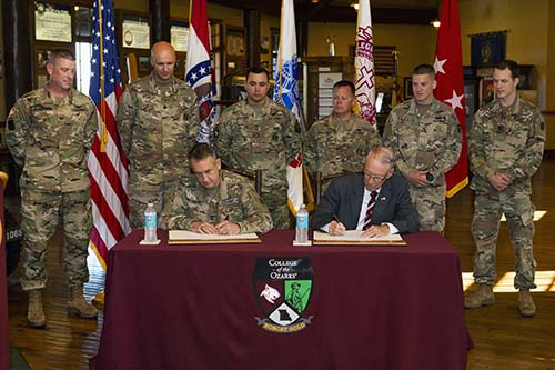 Brief ceremony for signing of new commissioning program at C of O.