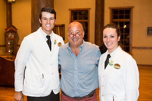 Eric Powell, business administration major, and junior Courtney Hendrix, psychology and business administration major, stop for a photo with television food personality Andrew Zimmern