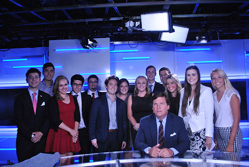 Christian Lingner pictured with other interns and Tucker Carlson