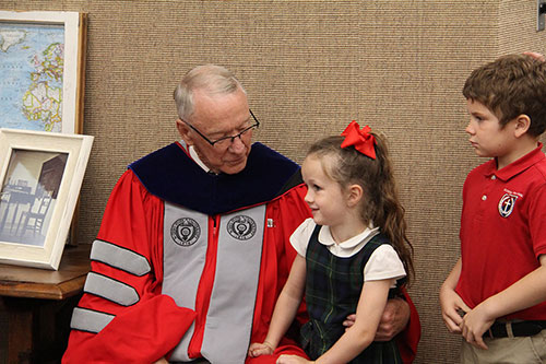 – Dr. Jerry C. Davis greets students at the laboratory school