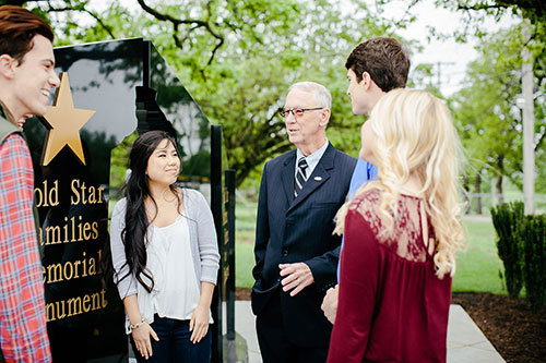 – President Jerry C. Davis visits with students at the Missouri Gold Star Families Memorial